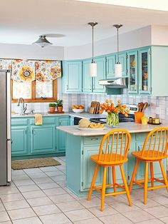 Update Your Kitchen on a Budget - loving the aqua and orange accents! Without a doubt, paint is the fastest way to a fresh look for the least amount of money!