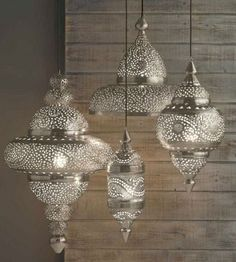 pendant lights to create a feeling the ceiling is higher Metallic accents. Love the design of the lamps, adds texture to the look!