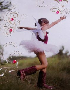 Young girl in cowboy boots, tutu and fairy wings. Can't get better than that!