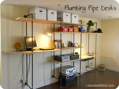 Plumbing Pipe Desk -- with adjustable shelves throughout  I really like the versatility of this design!
