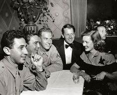 A NIGHT AT THE CANTEEN - Bette Davis & Joel McCrea chat with U. S. soldiers - Hollywood Canteen - Los Angeles - 1942.