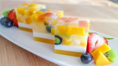 "This ain't your mama's ""fruit cake""! This light and refreshing beauty is an absolute showstopper, and nothing says ""summer treats"" more than these gorgeous cubes of fruit-embedded jelly. The coconut layer adds an extra tropical flare! The fruit combination I used: mango, papaya, pineapple, lychee, kiwi and blueberries, is a winning combination, but you can …"