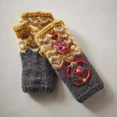 TATIANA HANDWARMERS - Exquisite, artisan-made handwarmers in soft, merino wool. Fleece lined. Hand wash. Imported. Exclusive. One size fits most adults.