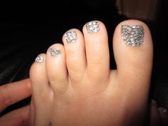 Rinestone toes! Steps: 1) Buy mini clear rhinestones... 2) Paint the nail in any color, let dry completely... 3) Use clear coat to glue the rhinestones onto toes/nails... 4) Brush on a few more layers of clear top coat and voîla!