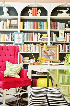 Your bookshelf is going to be colourful anyways, so you should embrace it! I love the colours in this (although I would use different fabrics...)
