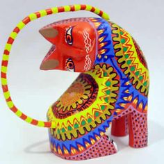 Alebrije - from Oaxaca, Mexico. Alebrijes are brightly colored Mexican folk art sculptures of fantasy creatures. The art form originated with Pedro Linares in the 1930's.
