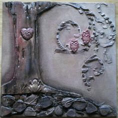 Mixed media canvas using airdry clay, corrugated cardboard and string.