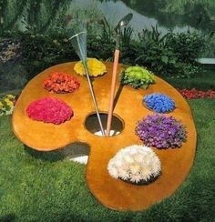 painter's pallet flower display.... inspiration idea for event entrance or on smaller scale for table decor