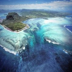 Aerial pictures appear to show an 'underwater vortex' in the Indian Ocean off the coast of the tropical island of Mauritius. The 'vortex' is really an optical illusion and is caused by a build up of sand and silt deposits along the coast of Mauritius All Nature, Science And Nature, Amazing Nature, Best Summer Holiday Destinations, Travel Around The World, Around The Worlds, Purpose Of Travel, Mauritius Island, Fiji Islands