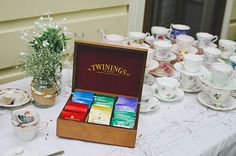 Love the miss matched tea cups, set up for self serve tea and coffee, on the same table as the wedding cake