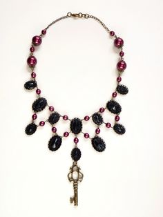 Black and burgundy cabochon necklace with key, handmade by The Black Cat Designs