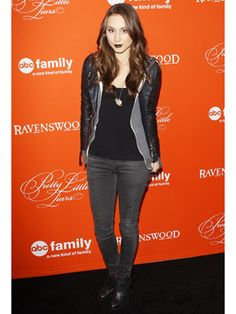 Troian Bellisario makes dark lips and an edgy ensemble look flawless on the Halloween episode premiere carpet!