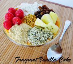 Tropical Sunshine Smoothie Bowl | Fragrant Vanilla Cake 1 large banana, frozen 1 cup frozen mango 1 1/2 cups frozen pineapple a few organic raspberries 1 large carrot, chopped 1/2 tsp ground turmeric 1 scoop raw vanilla protein powder (optional) 1/4-1/2 cup raw hemp milk or coconut milk (depending on how liquidy you like it, I like mine thick so I add less) 1 tsp pure vanilla extract stevia to taste (or your choice liquid raw sweetener)