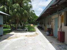 Tack room building on left, stables on the right.