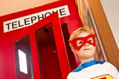 Made a telephone booth for Maddox's 4th birthday party. The box I got was too big, and I cut the holes too big, so it was kind of floppy. The kids had no idea what it was and had no interest in it! LOL!
