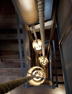 Natural lighting materials combine well with the steel-railed staircase.