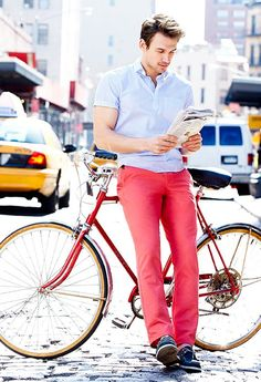 Shop this look for $226:  http://lookastic.com/men/looks/light-blue-shortsleeve-shirt-and-neon-pink-chinos-and-navy-leather-boat-shoes/1776  — Light Blue Vertical Striped Shortsleeve Shirt  — Neon Pink Chinos  — Navy Leather Boat Shoes
