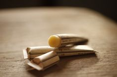 Rosewood lip embellishment in eco friendly tube