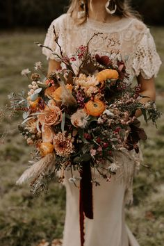 Beautiful bohemian bride wearing woven crown and lace wedding dress by Poppy Perspective holding huge wild flower bouquet in autumn colours by Emma Spowage Photography by Kelsie Low Photography - Fringe Wedding Dress, Boho Wedding Bouquet, Fall Wedding Flowers, Bride Bouquets, Bridal Flowers, Floral Wedding, Lace Wedding, Autumn Wedding Dresses, Autumn Flowers