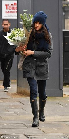 2/6/2017 - Meghan Brightens Up A Rainy Day With Flowers - Meghan Markle looked casually chic today as she stepped out to buy some flowers on a London high street. She was spotted shopping only a short stroll from Prince Harry's apartment within the grounds of Kensington Palace where she is staying while in London.