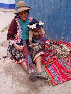 Multi-tasking mom, weaving and watching baby. Cuzco, Peru.