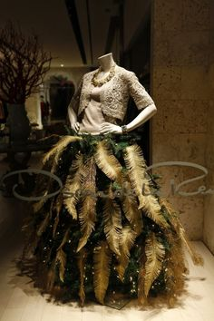 (Like idea of smaller gold ferns/feathers - but not so many. Shrug good idea.)