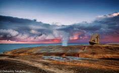 """The Bicheno Blowhole at Sunset - The life of a landscape photographer involves visiting places – and often – visiting the same place several times under different conditions. During my trip to Tasmania in December 2014, I overnighted at Bicheno. Bicheno has two main attractions – the penguins (which I see plenty of back in Victoria) and the blowhole (which is a bit of a novelty for me). Bicheno""""s blowhole is easily accessible from the car park at the edge of the beach – a mere 50 metres or…"""