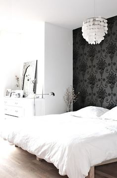Designers Guild wallpaper & bedding, Ikea lamp, bone inlay mirror