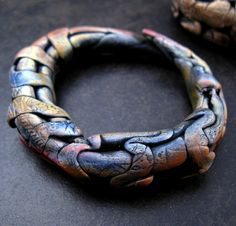 Hollow grid bracelets | Wonderfully colored and shaped polymer clay bracelet by Claire Maunsell