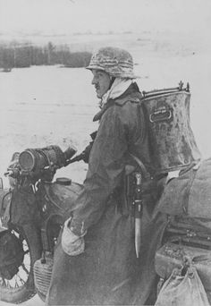 A motorcycle rider delivering some hot coffee or soup rations in cold winter conditions.