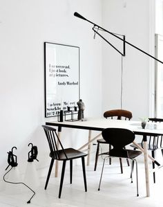 Black and white dining room with Ant chair from #FritzHansen and #Flos lighting
