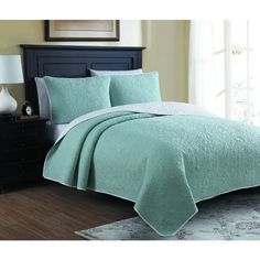 Designed with elegance and sophistication, this reversible quilt set will give your bedroom a stylish update. The richly colored fabric features a densely quilted pattern with fleury embellishments.