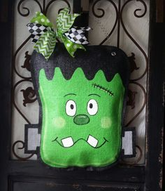 Adorable Frankenstein hand painted burlap door hanger, Halloween door decor or wreath. Can be personalized free Burlap Door Decorations, Burlap Door Hangings, Halloween Door Decorations, Halloween Wreaths, Halloween Wood Crafts, Fall Crafts, Holiday Crafts, Diy Crafts, Halloween Ideas