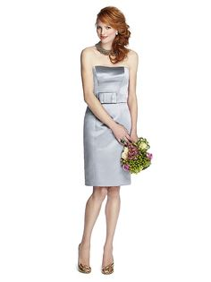 Cocktail length strapless duchess satin pencil dress with princess seams and wide bow detail at matching belt. Available in sizes 00-30W and 00-30W with extra length.View Size Chart  http://www.dessy.com/dresses/bridesmaid/5700/