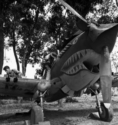 Burma World War 2: The Flying Tigers, 1942. Armourers Pat Hanley and Jim Musick overhaul cannons in the wings of Curtis P-40. George Rodger.