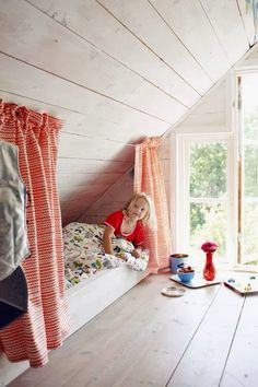 Kids bed under the eaves with curtains