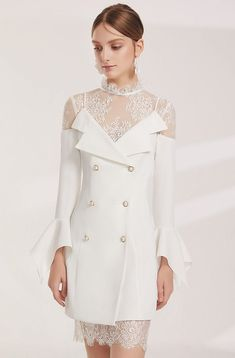 5b8fba11a04f White coat style tuxedo white dress with lace details and finishes around  the neckline and hem. Flounce sleeves and elegant jewelry to finish.