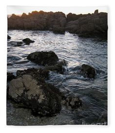 A large tidepool on the rocky shore of Pacific Grove at Asilomar State Beach creates a cool look on a warm blanket. Photo by James  B. Toy.  Blanket by Pixels.com.