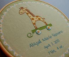 Adorable giraffe needle point.