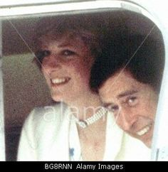 One of the few rare photos where Diana and Charles both look happy.