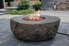 Bring the ruggedness of the outdoors to your backyard space with the Boulder Fire Table. This boulder inspired fire pit features superior warmth with adjustable Diy Fire Pit, Fire Pit Backyard, Landscaping With Rocks, Backyard Landscaping, Pergola Patio, Pergola Kits, Pergola Ideas, Landscaping Ideas, Modern Backyard