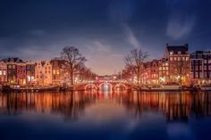 Picture of an illuminated bridge over canal at night, Amsterdam, Netherlands