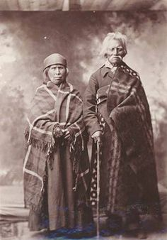 Colville couple in studio portrait, Stevens County, Washington, ca. 1907 :: American Indians of the Pacific Northwest -- Image Portion