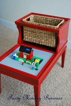 KIDS LOVE LEGOS! Re-purposed lego table.Both play area and welcome storage.