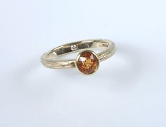Spessartite Garnet set in 18ct yellow gold on a 9ct yellow gold wire ring shank made by Alexandra Aurum 2014