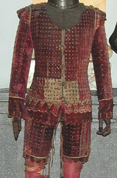 Coracina Red Velvet:  Doublet or jerkin, long cuffs with hanging filigree buttons, and advocacy for the thighs.   Website for Museo Lázaro Galdiano is in Spanish;  there is no note as to if this is an original piece or a reproduction, where it originated from or when it was produced