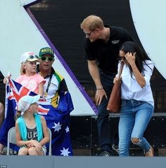 The pair paused to greet young fans as they made their way to their seats to take in the t...