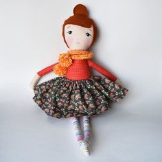 Meet Anna. Her copper hair with top knot is 100% wool felt. Anna's sweet face is hand painted. Her body and dress are made of 100% cotton fabrics....