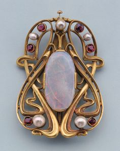 """Edward Colonna, Buckle, c.1900  Sculpted gold set with opal, pearls, garnets. France, Made for Siegfried """"Samuel"""" Bing's display at the 1900 Paris World's Fair."""