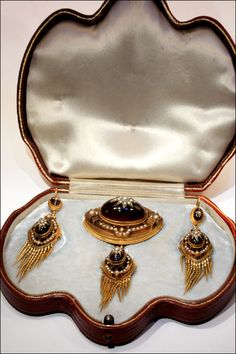 Victorian Revivalist garnet and pearl parure in 15k gold.  Earrings, Brooch and pendant drop in original fitted box.  Sold by VSterling on Ruby Lane.
